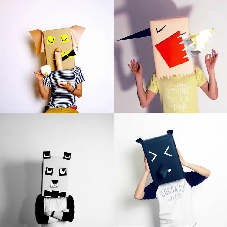 Capgrossos d'animals per a disfresses en una caixa de cartró