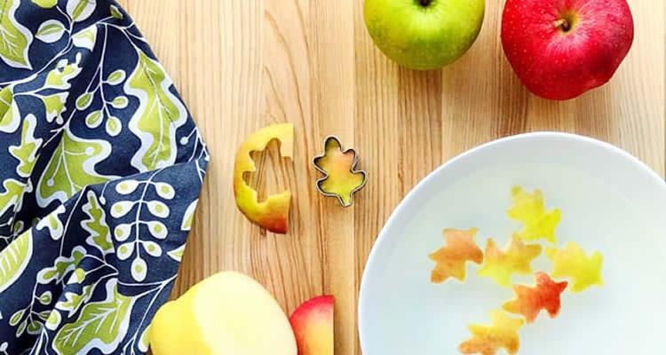 fulles fetes amb pomes i tallador